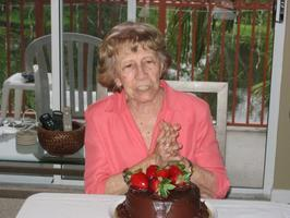 100th Birthday Party - Juana Riano - help her blow out...