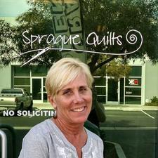Lois Sprague logo