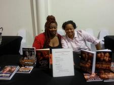 Quisha Dynae and Shmel Carter logo
