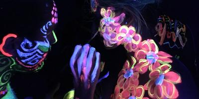 Paint in the Dark™  UV body painting class for couples
