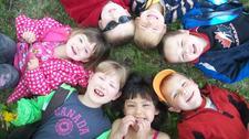 Wild Rose Montessori Child Care logo