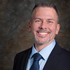 Mark J. Lucas, DTM, QS - Program Quality Director, District 100 logo
