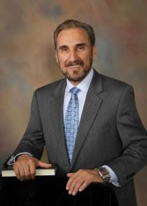 Nestor H. Praderio, MD, Founder of Face to Face, LLC logo