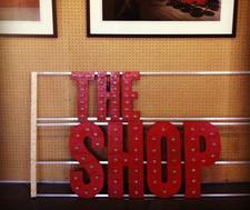 The Shop at Flywheel Press logo