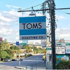 TOMS Austin  logo