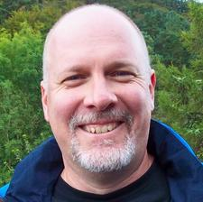 Dan Odell, Executive Director logo