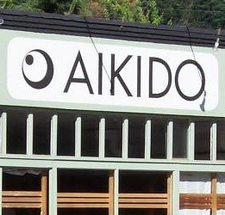 Suzane Van Amburgh, event host, Chief Instructor of Aikido Multnomah Aikikai logo
