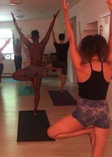 The Power Yoga Collective logo