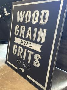 Liz - Wood Grain & Grits logo