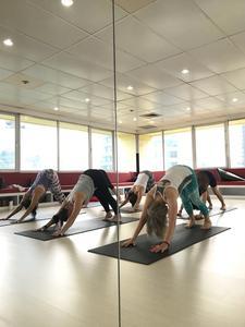 AMI Power Yoga logo