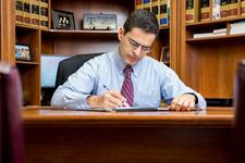 Prof. John Rizvi, Esq, The Patent Professor® logo