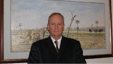 Dr Michael J Freestone. CPA. FCIS. FCIBM. MBA. DBA. logo