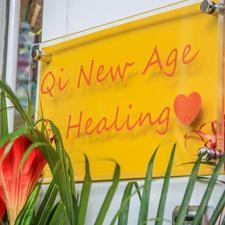 Qi New Age & Healing logo