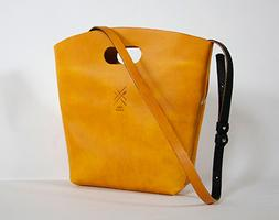 Leather bag making workshop using traditional leatherwo...