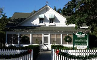 YP Naples Holiday Event-Historic Palm Cottage™...