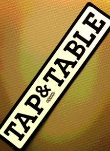 The Tap & Table logo